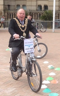 Lord Mayor rides an electric bike