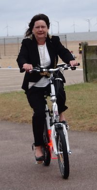 The Mayor of Great Yarmouth rides an electric bike